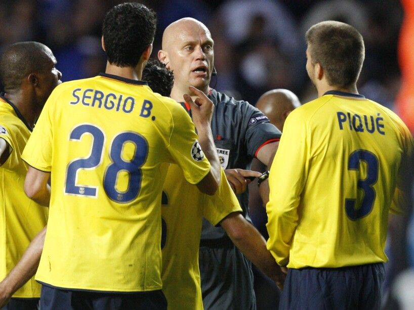 Sergio Busquets ,Gerard Pique , Tom Ovrebo