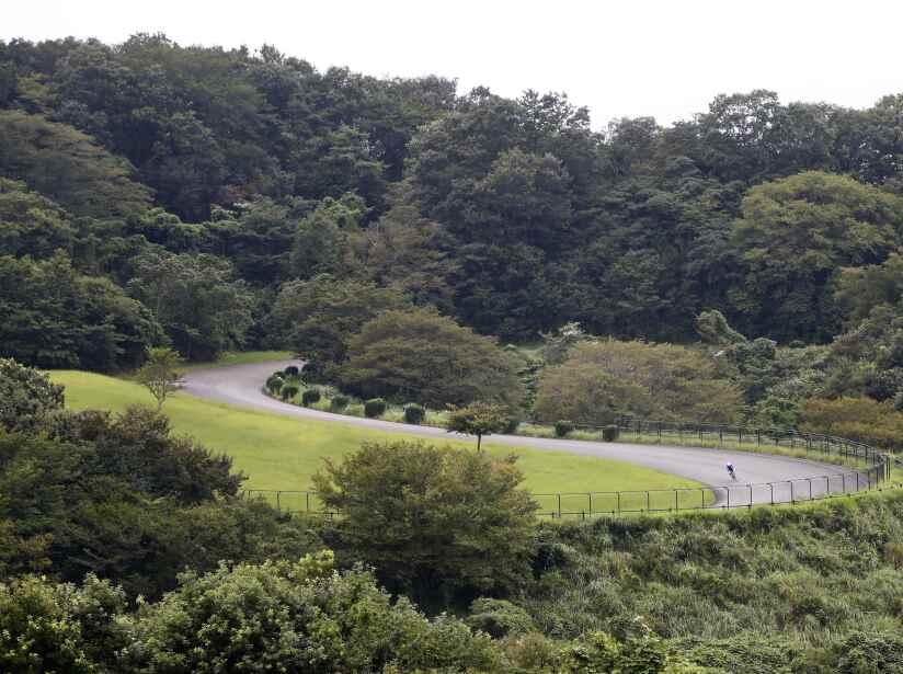 Cyclist rides his bike in Izu Mountain Bike Course for Tokyo 2020 Olympic games in Izu, Shizuoka prefecture