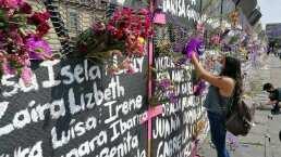Mujeres llenan de flores el muro que levantaron como 'protección' al Palacio Nacional