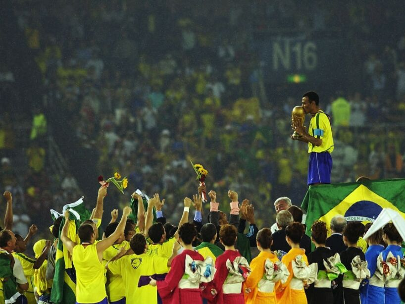 Cafu on the podium celebrates with the World Cup trophy