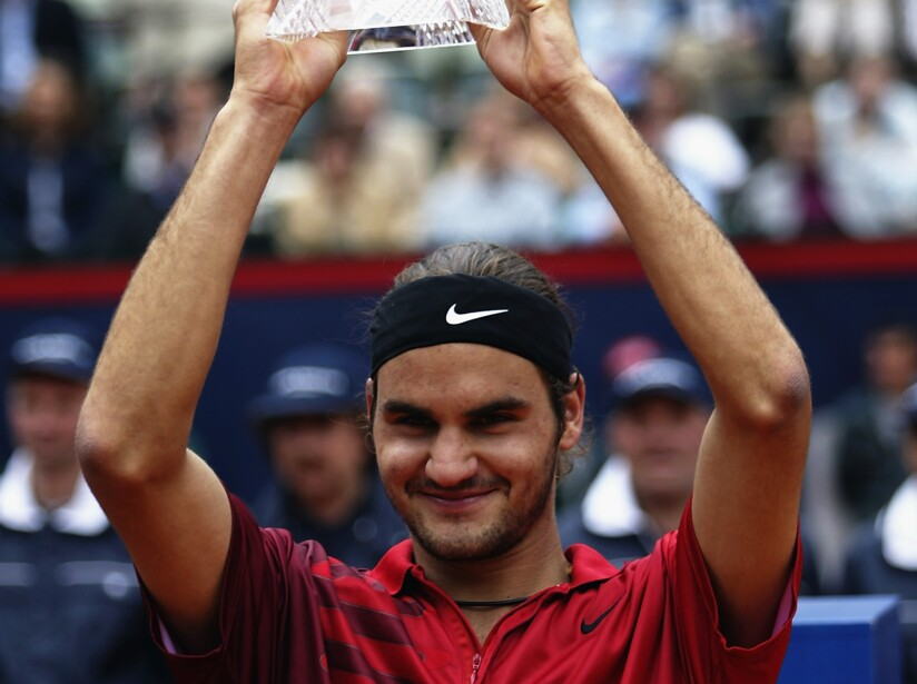 Roger Federer of Switzerland holds aloft the Masters Series trophy