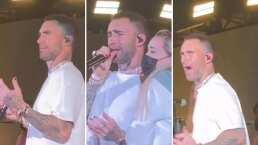Fan abraza a Adam Levine en pleno concierto y la reacción del cantante causó indignación