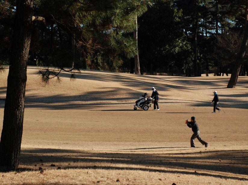 People play golf at Kasumigaseki Country Club in Kawagoe