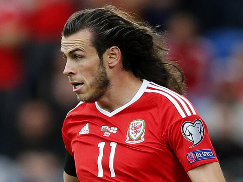 Gareth Bale with shoulder length hair after it comes loose during the FIFA 2018 World Cup Qualifying Group D match Wales and Georgia played at Cardiff City Stadium, Cardiff on 9th October 2016