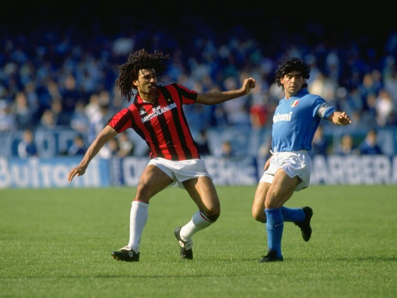 Ruud Gullit of AC Milan and Diego Maradona of Napoli wait for the ball to be passed