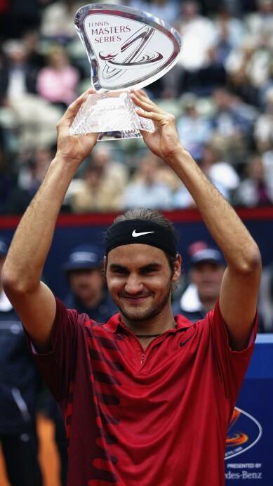 Roger Federer of Switzerland holds aloft the Masters Series trophy