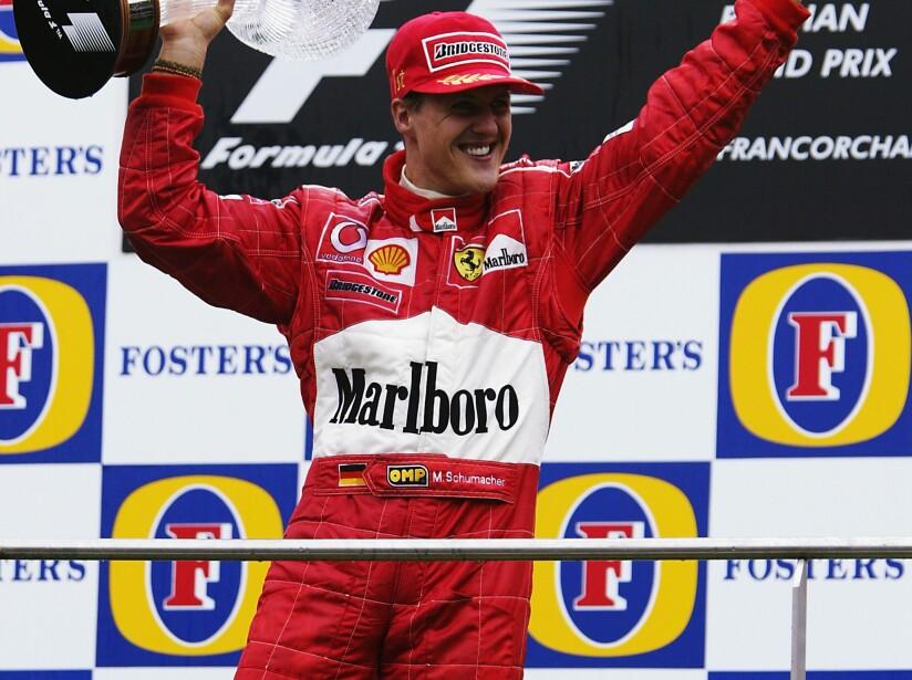 Ferrari driver Michael Schumacher of Germany celebrates on the podium