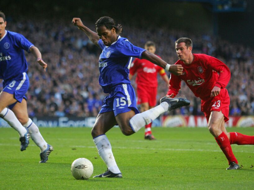 Chelsea's Frank Lampard (L) watches as t