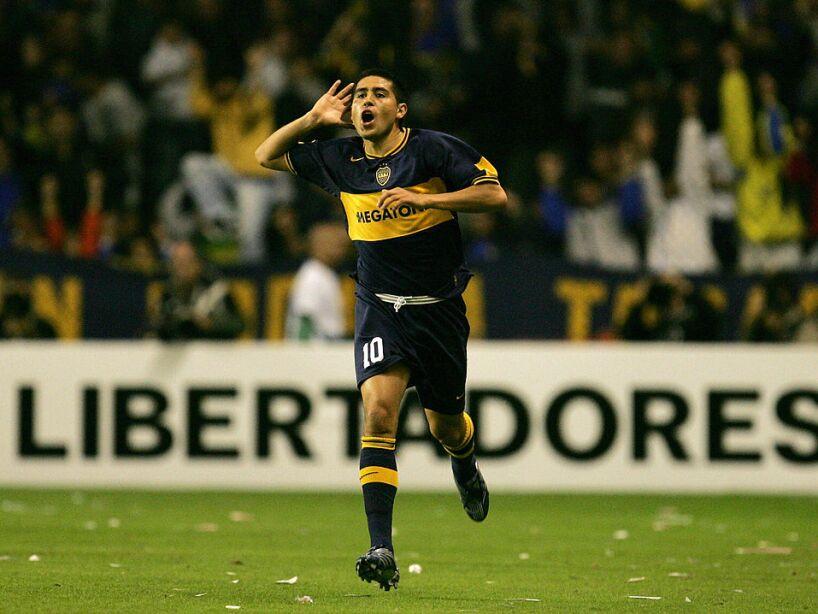 Roman Riquelme, of Boca Juniors celebrat