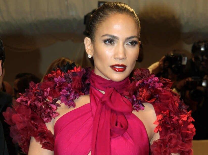 Singer Jennifer Lopez poses on arrival at the Metropolitan Museum of Art Costume Institute Benefit celebrating the opening of Alexander McQueen: Savage Beauty in New York.