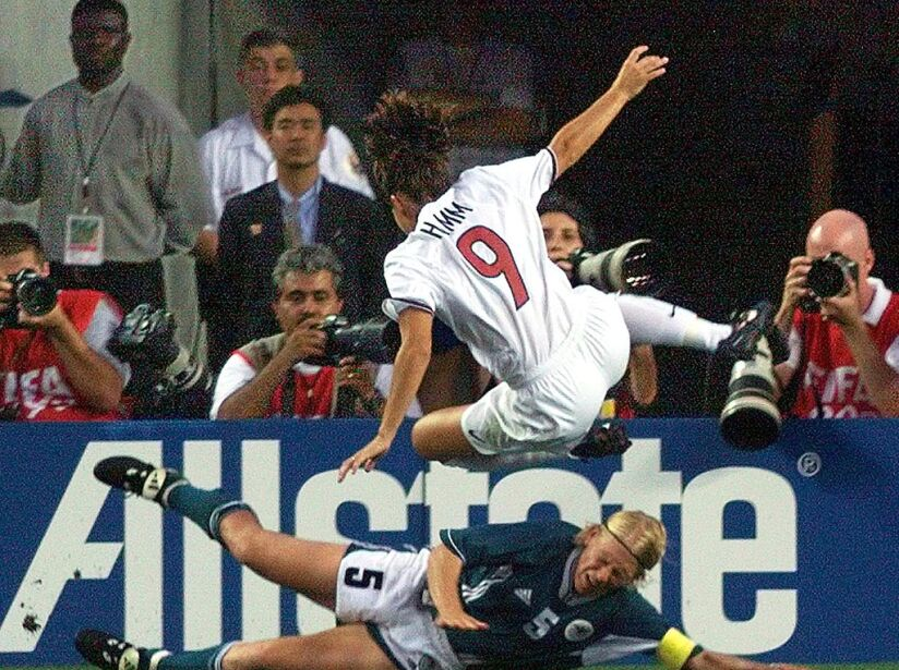 Mia Hamm (in the air) of the US and Doris Fitschen