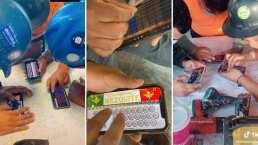 Trabajadores de construcción forman banda de corridos y sus instrumentos son ¡sus celulares!