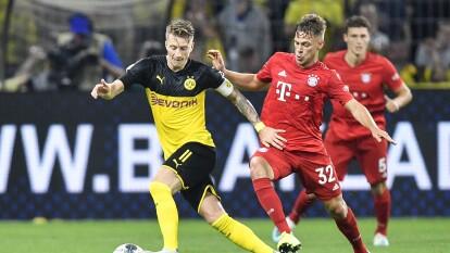 Bayern München y Borussia Dortmund chocan en un clásico histórico, sin público, ante los ojos del mundo que en plena pandemia de coronavirus disfrutarán, desde sus hogares, de 'Der Klassiker'.
