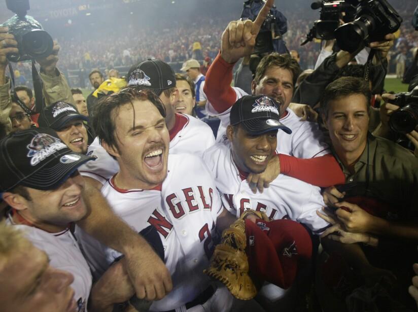 Scott Spiezio rejoices with teammates