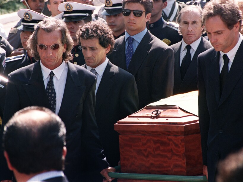 Formula One pilots Emerson Fittipaldi (L