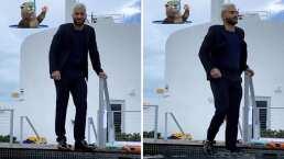 Maluma se metió hasta con zapatos a una alberca para tomar esta fotografía