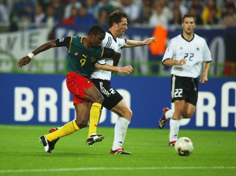Samuel Eto'o of Cameroon and Thomas Linke of Germany